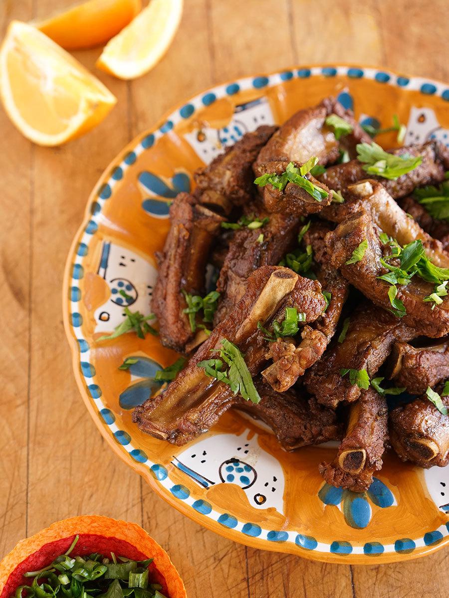 Côtes de porc à l'orange et au laurier